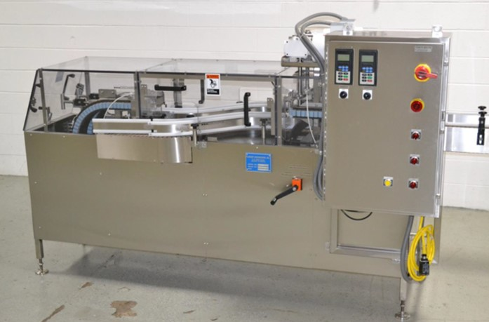 McBrady-Gripper Liquid Filling, Capping, Cap Sealing, Conveying & Labeling