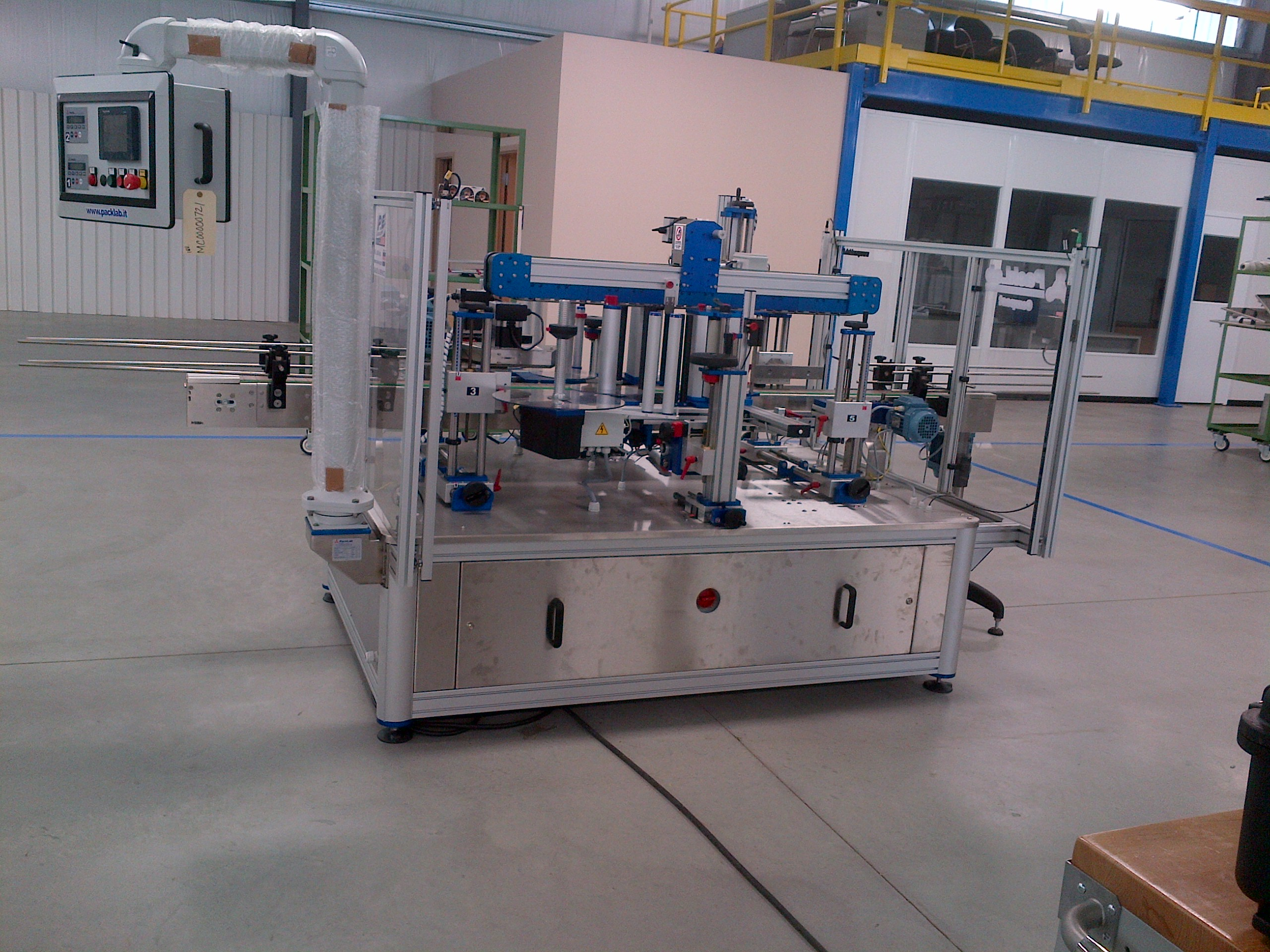 IMG-20140708-00219 Liquid Filling, Capping, Cap Sealing, Conveying & Labeling